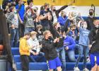 Minneota fans and players react after Bishop Drietz hits a three-pointer against Tracy-Milroy-Balaton Monday night.
