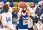 AJ Myhre launches a three-pointer against RTR on Friday in Minneota. Myhre made the shot.