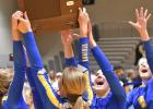 MINNEOTA CELEBRATED THE SECTION TITLE BY HOISTING THEIR TROPHY.