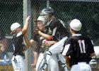 Celebrate, celebrate, dance to the music .... the old lyrics to a song seemed appropriate when catcher Tate Walerius jumped on Cole Sanow to celebrate the 5-2 playoff win over Madison. Cooper VanOverbeke was waiting for a high five (left) as Carter Schuelke (11) was joining the victory fun.