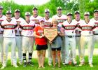 The Mudhens award for winning the Paul Larson Memorial Mudhen Classic was held by Paul's daughter Breanna and wife Wendy. The Mudhens are: (front row, left to right) Jake Leighton, Alex Pohlen, Beau Buysse, Brant Buysse, Preston Nuy and Austin DeVlaeminck. Back: Austin Buysse, Peyton Nuy, Zach Nuy, Tyson Sonnenburg, Danny Hennen, Bryce Gorder and Noah Scott.