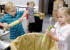 Students at St. Edward School helped husk sweet corn as a teaching tool that engages students while building connections to agricultural heritage and rural communities.   This is all part of the Farm to School program. Doing the honors were Charlie Myhre and Kaitlyn Gorecki.