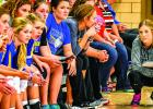 Coach Hayley Fruin and her bench during a tense part of a game.