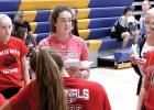 Taya (Kockelman) Lindahl (upper, left), talked things over with her players at the Minneota scrimmage.