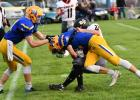 Minneota's Blake Reiss ran over Lac qui Parle Valley defender Dustin Poitter.
