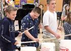 "Enjoying making music on buckets at the 2019 Elementary Spring Concert, ""Sun, Sand, Surf!"" in Minneota last week were: (left to right) Destin Fier, Kyler Lozinski and Tate Peterson. All are sixth graders."