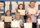 Congratulations to March Viking Valors! Elementary students are (left to right):  Olivia Claeys, Brycen Myhre, Talia Fier, Madison Minnehan. Back: Tana Gillund, Joey Clark, and Brooke DeSmet and Destin Fier (inset, top, left).
