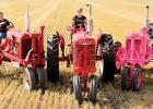 Chad Nuese (left) on his tractor with step-son Ty on a tractor and Stacie on her pink tractor on the right.