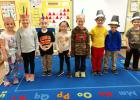 St. Edward Kindergarten kids celebrated by having their own classroom feast for Thanksgiving. They are: (front row, left to right) Kaitlyn Gorecki, Stella Gorecki, Colton DeRoode, Brisbyn Traen, Audyn Traen, Charlie Myhre, William Jones, and Noah Myhre.