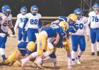The Rybinski brothers, Joey and Anthony, combine to sack MACCRAY quarterback Isaac Strommer in the first quarter Tuesday night in Minneota.
