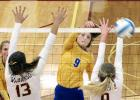 Abby Frie smashed the ball for a kill against Wabasso as teammate Morgan Hennen watched.