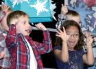 First Graders Blayze Hulzebos (left) and Kienzlee Sawyer seemed to be having a good time during the Minneota Elementary Christmas Concert last week.