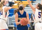 Abby Hennen (center) splits the Canby defense on the way to the basket where she scored two of her 19 points on Friday night.