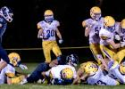 MINNEOTA'S GOAL LINE STAND came with Payton Hess buried by Minneota tacklers.