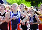 Grace Drietz was in the middle of the back, but she broke away and finished third in the 800-meter prelims at the state meet.