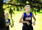 Grace Drietz ran through the trees with teammate McKenzie Ruether right behind her.