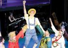 Pinocchio was Jacob Haen being hoisted by Jackson Jeremiason as Peter Pan (right) with Chesney Panka as the white rabbit (right) and Emma Lipinski on the left.