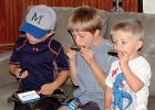 Harmon and Nolan Van Keulen and Bennet Myhre (left to right) got their harmonicas and tried them out right away. Getting the kids involved was a good way to drive home the kind of music played by Smithson's group.