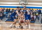 Jacob Citterman and Logan Sussner defend YME point guard Elliot Korstad.