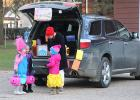 """Jenny Buysse handed out candy from her """"Candyland"""" trunk."""