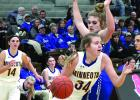 Jeren Rost drove toward the basket past BBE's Karisa Jones. Abby Hennen (left) watched the action.