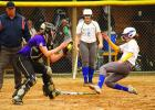 Kaylee Johnson (right) of Minneota went into her slide and despite the ball getting to Montevideo catcher Sydney Zinnel, Johnson was safe.
