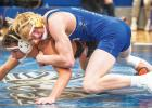 Jonah Gruenes controls a recent opponent before notching one of his wins this season. Gruenes is a co-captain on the Minneota team this season.