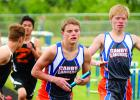 Jared Josephson took the baton from Anthony Wollum (right) in the 4x800-meter relay. The Canby-Minneota squad finished in second with Wollum, Josephson, Full and Jalyn Ufkin running the event.