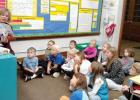 Julie Pohlen read to the kindergarten, first and second grade students for Read for the Record at St. Edward School in Minneota.
