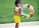 Making sure he has his innertube along for the plunge into the Minneota Swimming Pool last week was Kai Miller.
