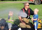 Whether getting wet, walking the sobriety line, soaking each other or waving to the emergency helicopter, kids were having fun at National Night Out Tuesday in Minneota.