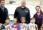 Mary Kampa's kindergarten class (left) as well as and Jackie Skillings' First and Second graders received Catholic United Financial coloring books from their long, but soon to be retiring sales Rep. Dan Markell (center) and their new sales rep six year Catholic United Financial veteran; Brian Zitzmann (left).