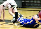 From the floor, Minneota's Morgan Kockelman shoveled the ball to a teammate.