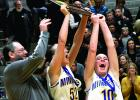 Captains Lydia Sussner (left) and Morgan Hennen celebrated with the Section 3A Championship trophy.