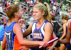 Lizzy Gillingham (right) was all smiles as she welcomed RyAnn Hansen with a hug after the 4x400-meter relay team placed second and earned a trip to the state.