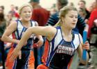 Lizzy Gillingham runs relay.