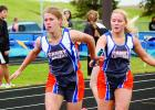 With a look of determination on her face, Lizzy Gillingham took the baton from Kaylie Hemish in the 4x200-meter relay, which Canby-Minneota won in 1:53.4.
