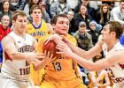 Logan Sussner comes down with one of his 15 rebounds and fought off Springfield's Ivan Hovland (left) an Isaac Fink.