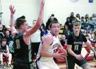 Logan Sussner drove to the basketball against Heron Lake-Okabena-Fulda defenders Tyler Madson (0) and Eli Fest (11).
