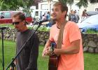 Mark Colvin, left, and Jake Moravetz of Broken Oak entertained Thursday night while the first Farmers Market of the year was going on behind them in the west parking lot.