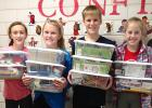 Pictured with St. Edward School's shoeboxes are: Kate Badgett, Madison Hennen, Leo Hennen and Sarah Gruenes.