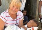 Mary Maher holding a Haitian baby.