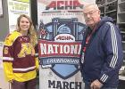 Melissa and her grandfather, Bill, at the national tournament.