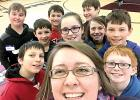 "Elizabeth Miller's class has been digging into some hard subjects, but they've also taken the time to have a little fun as well. Miller shot a ""selfie"" (left), with a bunch of her students in the background."