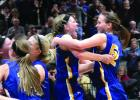 Morgan Hennen and Lydia Sussner (right) celebrate the victory as their teammates rush to join them.