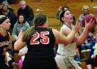 Morgan Hennen scored 19 points to lead Minneota. She got past Megan Rademacher on her way to the basket.