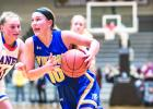 Morgan Hennen drives to the basket in the section 3A tournament. She has scored over 1,000 points in her career with Minneota.