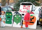 """At the """"Pick your nose"""" trunk was Seth Hennen and daughter Averi on the left. The trunk display was made by Shelly and Natalie Ratajczak (right)."""