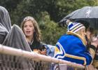 Minneota Homecoming Queen Molly Krog got a bit wet as others used umbrellas during the Minneota win over MACCRAY, 36-8.