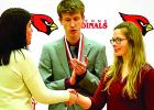 Rachel Engels (right) is congratulated for her first place honor. Sean Dilley applauded her (center).